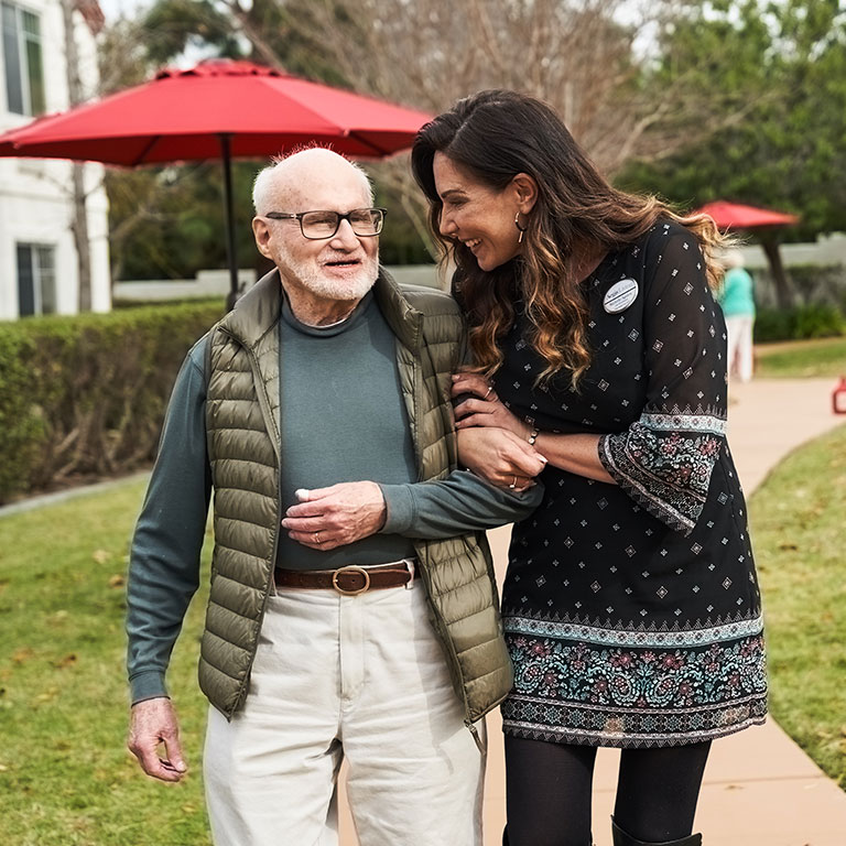 resident walks with staff