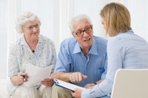 senior couple geting advice on paying