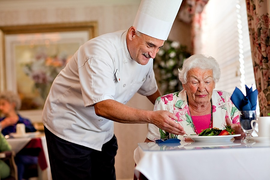 chef serving woman lunch