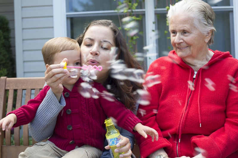 Family Blowing Bubbles | Kent