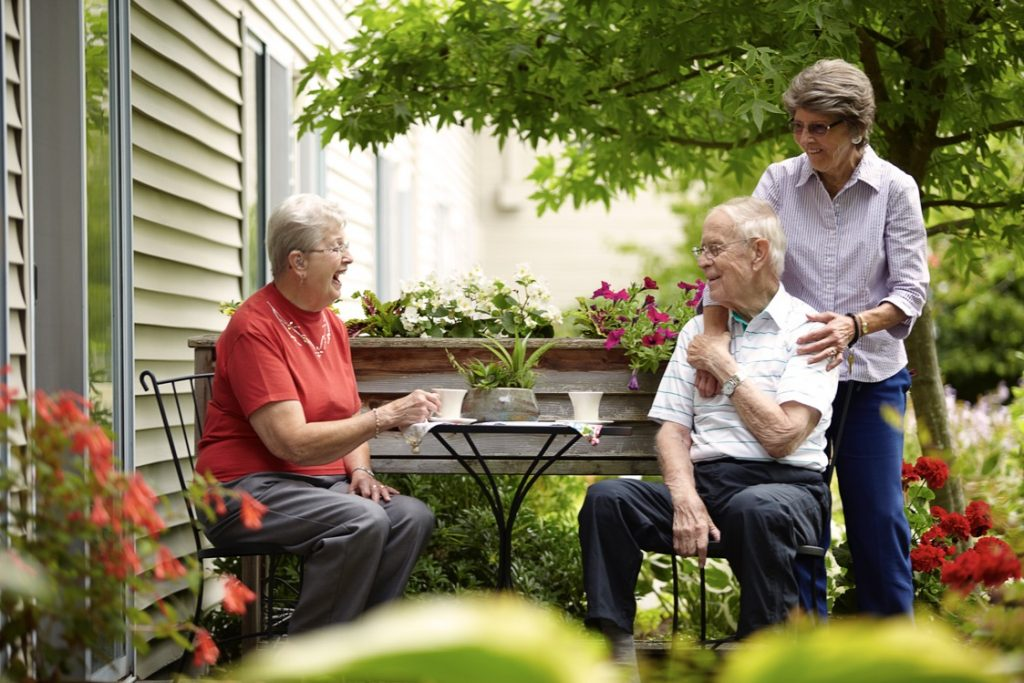 residents laughing in courtyard