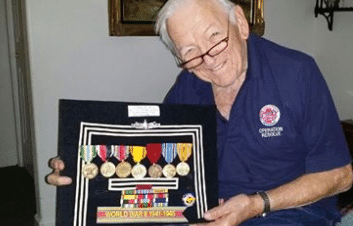 Art Peterson holds display of military medals