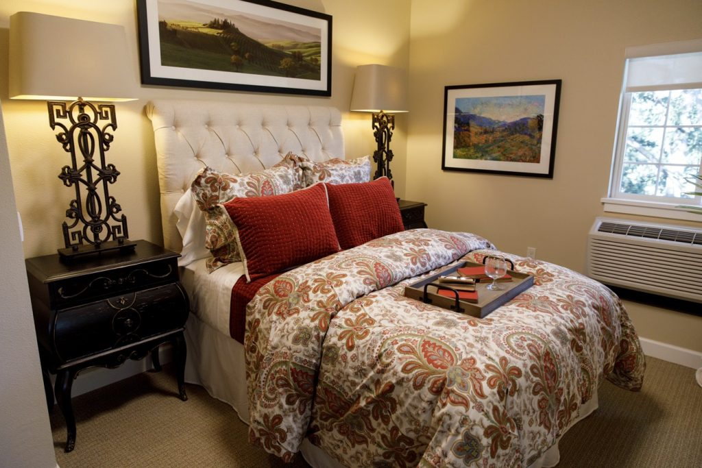 red bedspread in one bedroom