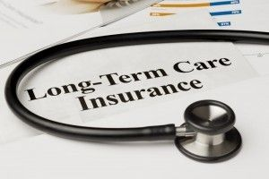 a stethoscope on the the table with forms for Long-Term Care insurance
