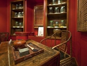 Wooden desk and shelves with old fashioned apothecary tools