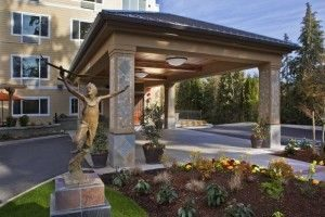 Garden sculpture of playing child outside Aegis Living entrance