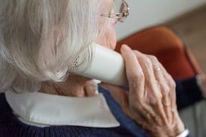 hearing loss senior with phone