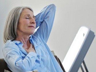 a senior woman receiving Light treatment