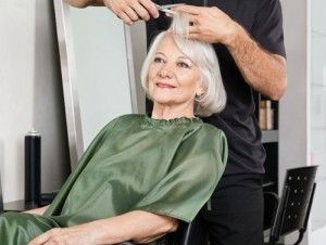 a senior woman getting a haircut