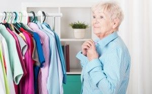 Senior choosing clothes from closet