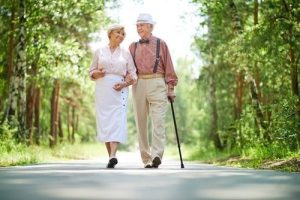 a senior couple walking