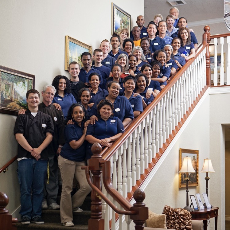 Employees Posing for Photo on Stairway