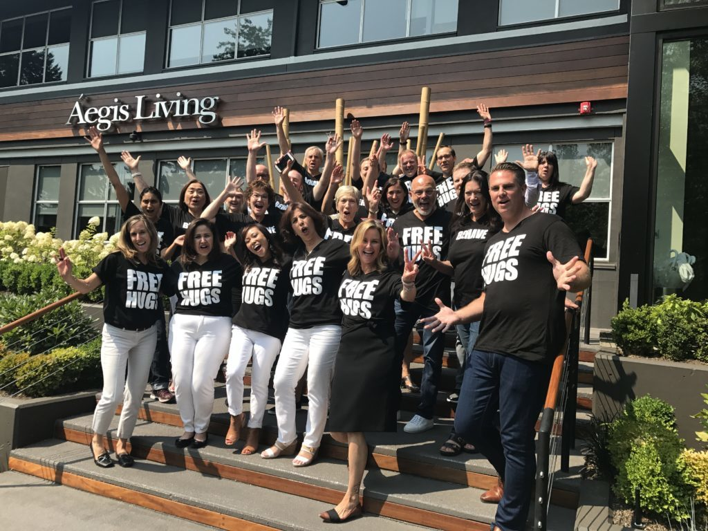 Staff wearing 'free hugs' shirts