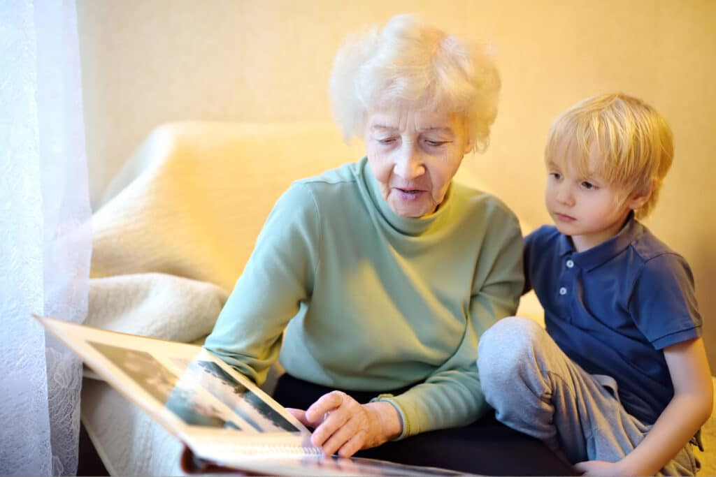 Where to Begin woman with grandson looking at photos