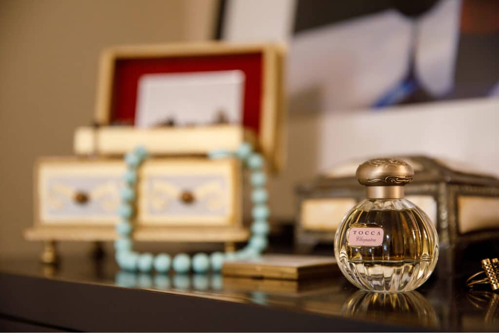 Where to Begin dresser with jewelry and perfume