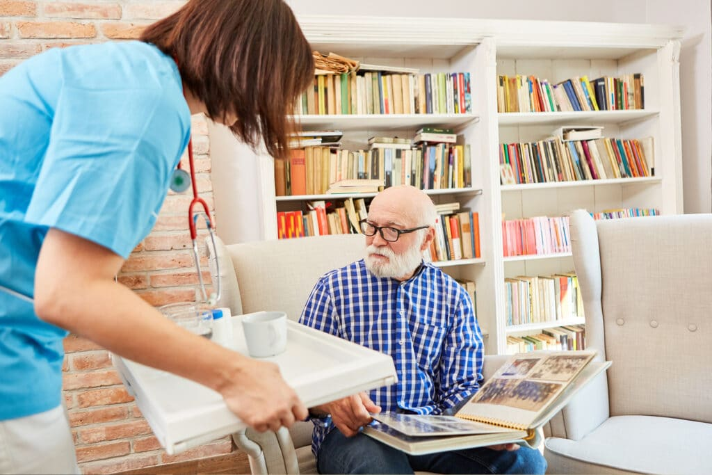 Where to Begin caregiver bringing medication