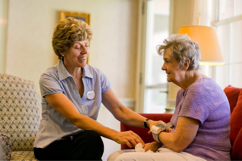 Where to Begin nurse taking resident blood pressure