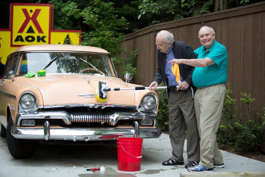 Where to Begin two men washing a car