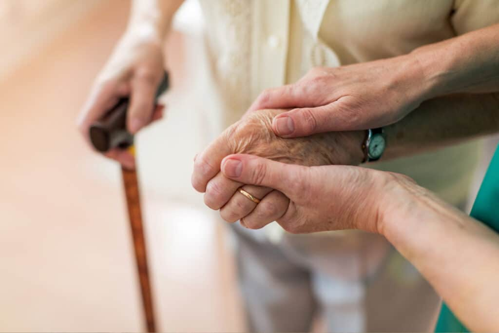 Where to Begin helping a resident walk with a cane