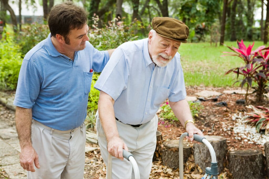 Where to Begin helping a resident walk with a walker outside