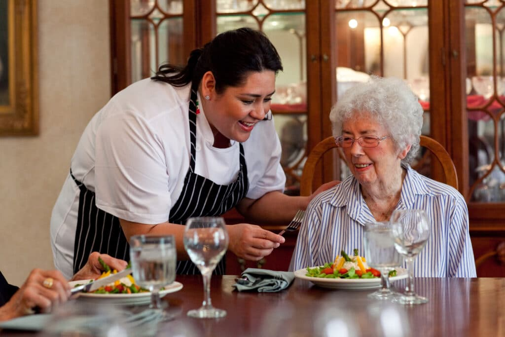 Where to Begin Chef bringing meal to resident